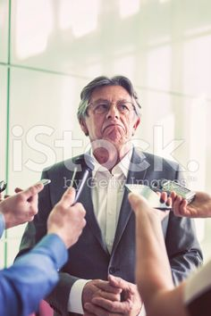 Journalists questioning a mature politician royalty-free stock photo