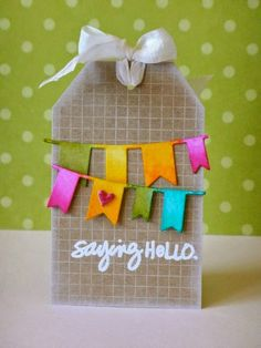 Adorable tag by Donna Mikasa using the  Simon Says Stamp Exclusive Banner die. September 2014