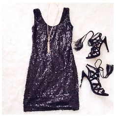 """Black Sequin Mini Dress This sparkly sequin dress is fun & flirty. The dress is stretchy & fitted.{actual color of item may vary slightly from photos}  •shoulders/chest:13.5"""" •waist:12""""w •length:29"""" •hips:115""""  Material:tags cut ️hand wash  Fit:true Condition:no rips no stains  ❌no holds ❌no trades ♥️️bundles of 3/more items get 20% off🎊🎊 As u wish Dresses Mini"""