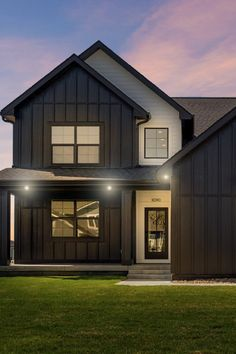 This modern farmhouse is a great example of how to create a striking exterior: a bold, two-tone color scheme; HardiePlank lap siding and HardiePanel vertical siding for visual texture. . Home by Dynasty Homes, Johnston, IA Farmhouse Front Porches, Modern Farmhouse Exterior, Modern Farmhouse Style, Farmhouse Ideas, Farmhouse Design, Siding Colors, Exterior House Colors, Vertical Siding, White Siding