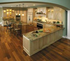 Perimeter - Fieldstone Cabinetry Glen Cove door style in Maple finished in Natural. Island - Cherry finished in Natural.