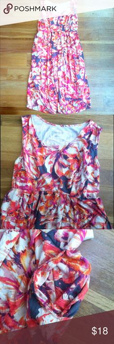 """BNWT Liz Lange Maternity Floral Print Dress - XL Brand new with tags, never worn. Pretty floral print with hues of coral, orange, and purple! Has side pockets which are deep enough to hold your phone, lipgloss, etc. Tie waist in back. Length is 38.5"""" and bust is 16.5"""" flat (33"""" doubled.) Smoke and pet tree home. Looking to only sell on Posh! Offers always welcome! Liz Lange for Target Dresses Midi"""