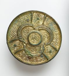 """Celtic brooch  - """"It turned out, quite remarkably, to be this Celtic disc… It's extremely exciting… It's a very rare example of its sort within the collection… shows contact between the British Isles and Norway in the Viking period … objects seized as loot in this country and taken back.""""  He believes that it was originally made in Ireland or Scotland, that it came from a shrine or a reliquary, and that the Vikings converted it into a brooch by attaching rivet holes and a pin."""