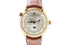 """www.valuecollection.com/public/1149/oggetti/294/index_colore2.swf.htm Jaeger-LeCoultre, """"Geographique"""", Ref. 169.1.92. Made circa 1995. """"World Time"""", center seconds, self-winding, water-resistant, 18K yellow gold wristwatch with date, 45-hour power reserve, day and night indication and an 18K yellow gold Jaeger-LeCoultre buckle. With box and certificate. Very good condition."""
