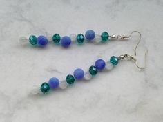 Diese Ohrringe aus facettiertem Glas, Achaten und Cateye-Perlen sorgen für einen einzigartigen Auftritt.  Trage Deine Perlen auf einer Hochzeit, ...