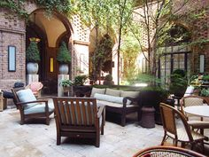we are bonkers for courtyard plans...look at the brickwork paired with steel french doors.  you can tell this is in the city because the light source is only from above, but wouldn't this be a lovely configuration for a home?  reminds me a little of a. hays town, the famous louisiana architect.