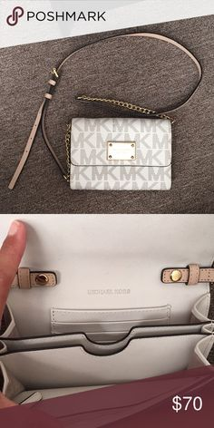Michael Kors White Phone Crossbody Michael Kors white signature crossbody that is meant as a phone wallet with five slots for cards and a zipper pocket. There are a couple small marks inside but not at all too noticeable. MICHAEL Michael Kors Bags Crossbody Bags
