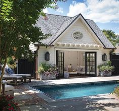 """The pool house is a popular """"flophouse"""" for the family as well as neighborhood k. The pool house is a popular """"flophouse"""" for the family as well as neighborhood kids. Small Pool Houses, Small Pools, Pool House Designs, Pergola Designs, Pergola Kits, Pool House Plans, Inexpensive Landscaping, Landscaping Ideas, Converted Garage"""