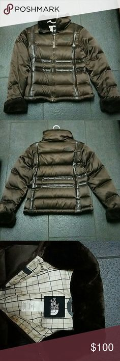 Last chance! North Face Goose Down Puffer Jacket Gently used! Rare North Face 550 Goose Down Puffer Jacket -only worn a few times.  -Goose Down Jacket with faux leather piping down the sides of the front of jacket & down the back of the jacket (see 1st & 2nd photos that show the piping detail -Chocolate Brown color -Faux fur on neckline & cuffs -women's size small -2 zip pockets on front  3 inner pockets on inside (one for headphones, cell phone & smaller pocket for small items) see last…