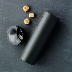 A slender stainless steel tumbler with a cool grip feature and swivel lid.