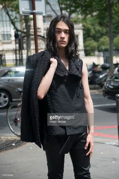 Model Louis Kurihara wears all Ann Demeulemeester on day 3 of Paris Collections: Men on June 26, 2015 in Paris, France.