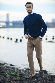 A navy blue crew-neck pullover and camel dress pants will showcase your sartorial self. Dark brown leather loafers will add some edge to an otherwise classic look.