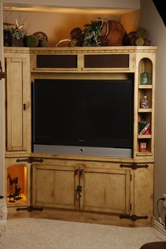 rustic timber and log entertainment centers and bookshelves | Hand Made Rustic Entertainment Center by Studio Wetz | CustomMade.com