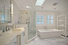 Contemporary Master Bathroom with Undermount sink, Handheld showerhead, Complex Marble, Skylight, Wall sconce, Crown molding