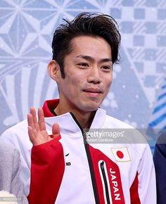 Daisuke Takahashi of Japan waits for his score after competing during the Men's Figure Skating Short Program on day 6 of the Sochi 2014 Winter...