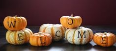 Cute! A painted pumpkin welcome!