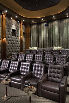 A private home theater with comfortable Chesterfield leather recliners for seating, and a sofa in the back for those who want to lounge. (via Portfolio - traditional - media room - los angeles - by Jennifer Bevan Interiors)