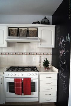 white kitchen with blackboard wall