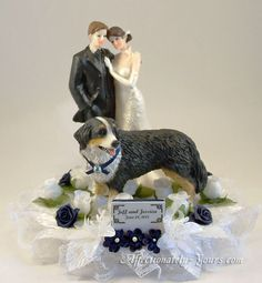 Customized dog with bride and groom wedding cake topper. Shown with Bernese mountain dog in white with navy blue accents. Personalized hair color changes. Includes name and wedding date plate.  http://www.affectionately-yours.com/yours-mine-and-ours-wedding-cake-topper/