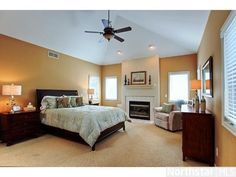 Large vaulted master #bedroom with a fireplace and master bath!