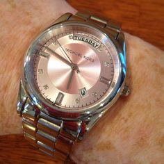 Pink with diamonds Michael Kors watch Stainless steel pink face with date and day of the week option and diamond number indicators Michael Kors Jewelry