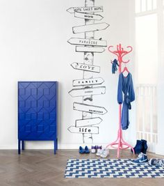 Directions wallpainting!  This would be adorable on the wall at the landing between the doorways! Live this and the pink coat hook! ...or just put coloured hooks on the wall!