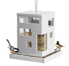 If you're keen to attract birds into your garden, and love the opportunity to see them feeding, then this bird cafe by Umbra is both well designed and practical.