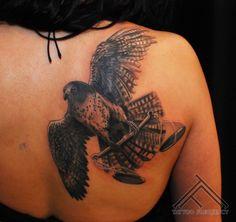Description: falconlibrascalesbirdtattoo