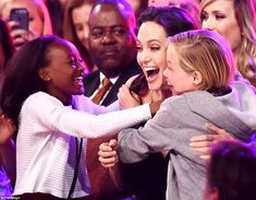 Supporting their mom: Angelina Jolie received hugs from her children Shiloh and Zahara when she won Best Villain for Maleficent at the Kids' Choice Awards on Saturday night