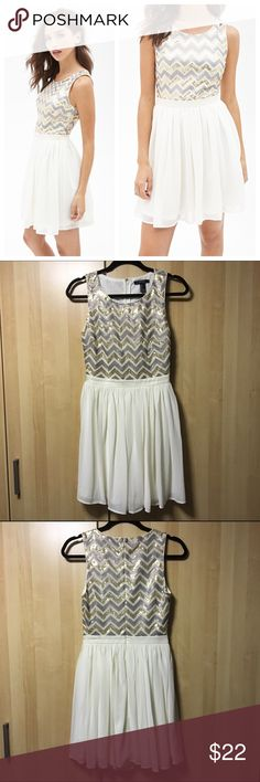 F21 Chevron Sequin Dress Sparkle and shine in this chevron sequin a-line dress. Sleeveless top is in a chevron gold and silver alternating pattern with crochet detail and bottom is beautiful cream colored chiffon skater style multilayered. Zippered back with eye-hook at top. Perfect for a holiday party or night out. Like new condition. Questions welcomed. Forever 21 Dresses Mini