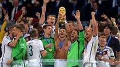 Mesut Oezil of Germany lifts the World Cup trophy