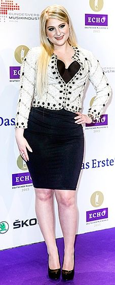 The pop star looked stylish in a white bedazzled blazer and a violet curve-hugging minidress.