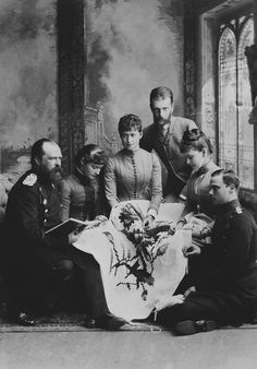 """Left to right:  Grand Duke Ludwig of Hesse with three of his four daughters - Princess Alix of Hesse, Princess Irene of Hesse and   Princess Elizabeth (Ella) - with her fiance, Grand Duke Sergei Mikhailovich, on her right. Kneeling in front is Grand Duke Ludwig's heir, Prince Ernst (""""Ernie"""")."""