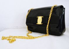 Cute small black patent leather purse with gold tone hardware piece and chain strap Purse has 1 outside pocket, Flap with magnetic button to close, 3 sections and 1 inside zippered pocket. Measures: 8'' x 6'' x 2'' Strap: 44'' with a 22'' drop #B205 PRICE: $30