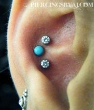 Triple conch piercing.  Sssoooo cute..but I'm barely surviving just the ONE conch piercing.  Can't imagine 3 all at once.