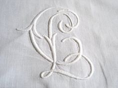 Interlaced monogram letters CL or LC on a fine pure linen sheet sold by chatelaine-chic.
