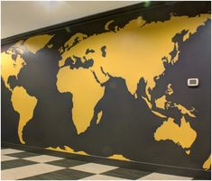 Arteriors has been creating Global Branding for hospitality venues by hand painting  murals of world maps.  A highly graphic world map in Charcoal Gray and Curry Yellow dominates a study hall in a Community Clubhouse at Flanders Hill, Westborough, MA.