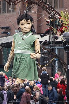 Little Giant Girl walking along Strand Street, Liverpool waterfront, Merseyside, UK