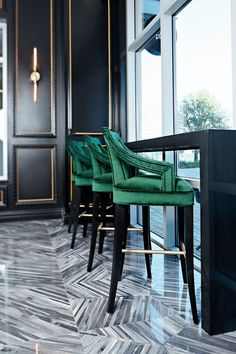 With an intricate brass chandelier, emerald armchairs and a marbled floor, this macaron bakery from Contour Interior Design shines with Art Deco glamour. A crescent-shaped bar showcases the colorful macarons available to customers. Estilo Interior, Gray Interior, Best Interior, Modern Interior Design, Interior Design Inspiration, French Interior, Green Bar Stools, Green Chairs, Art Deco Home