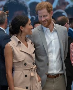 The Duke and Duchess of Sussex exchange a loving glance during their visit to the Nelson Mandela Centenary Exhibition on July 17, 2018.