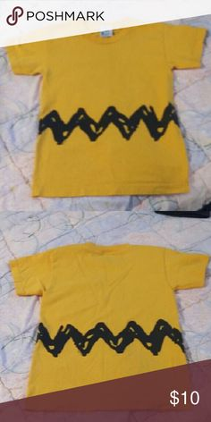 Charlie Brown Shirt By Peanuts Charlie Brown Shirt By Peanuts.  Size Youth Medium. Which is size 10 to 12. Peanuts Shirts & Tops Tees - Short Sleeve