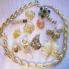 Some vintage pieces: necklace, earrings, bracelet, brooches, and a tie clip.