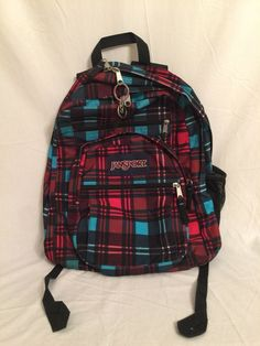 2b7a2507bfc Red and Blue plaid design with black and white accents.