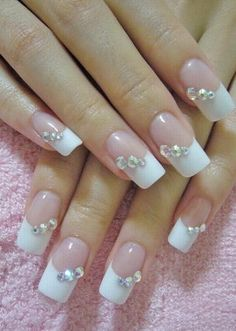 Bride's Wedding Day Nails.  A great look for your wedding day or any special occassion.  Clear rhinestones are just enough glitz to be stylish yet not overbearing.  If you want to do something to match the colors of your wedding you may want to put rhinestones on only the pinkie nails or just the ring finger nail.  After all, all eyes should be on the bride....not her nails.