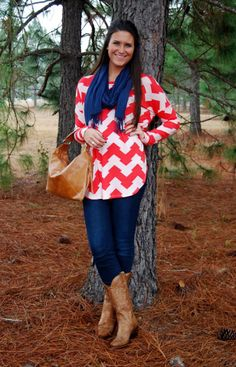 BREEZE ON BY IN CORAL Our patterned tunic tops have been best sellers, and this one in coral had our website staff drooling! We didn't even mind the rain during the photo shoot!  Our model is wearing a medium and is 5'7.