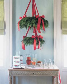 """Cedar Wreath """"Chandelier"""" Holiday Decor Ideas   Martha Stewart Living — This Scandinavian-style greenery """"chandelier"""" is an eye-catching way to draw guests to a holiday cocktail or buffet table."""