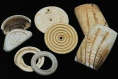 African made shell ornaments and their European made counterparts / copies of glass & porcelain. Trade beads.
