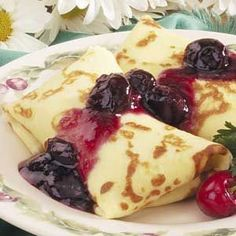 crepes with cheese blintz filling. I substituted fresh strawberries (when they are in season) or strawberry preserves (out of season) for the fruit topping!