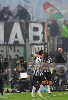 Carlos Tevez (L) of Juventus FC celebrates after scoring the opening goal during the Serie A match between AS Roma and Juventus FC at Stadio Olimpico on March 2, 2015 in Rome, Italy.