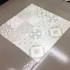 Porcelain and moroccan/patch-work tiles used as an insert. 24x24 inch tiles